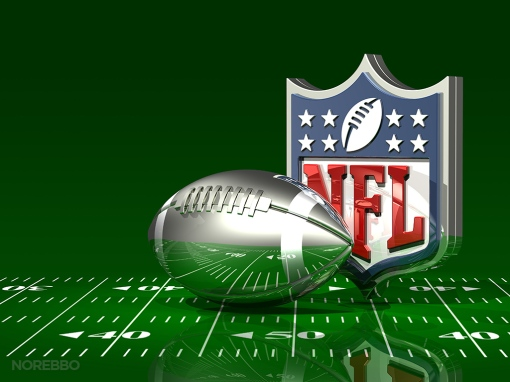 Silver Football and NFL Logo On Top of a Green Field